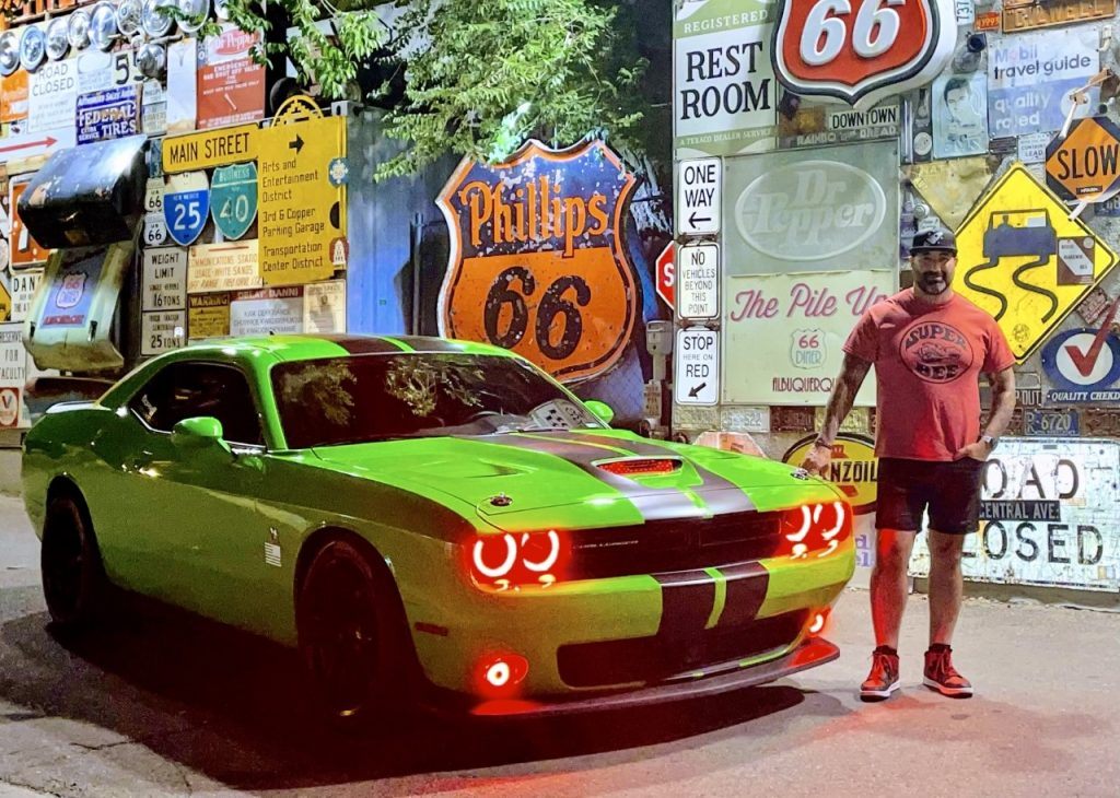 Nathan Sanchez of the Storehouse with his green muscle car