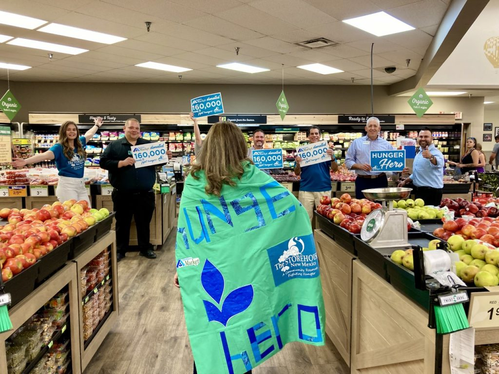 Hunger Hero, Yvonne, is celebrated by the staff of both Storehouse and Albertsons Market